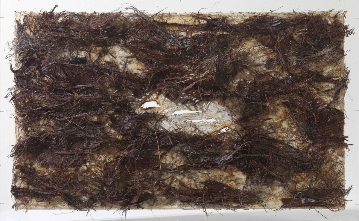 Mixed media on canvas:   Wood sticks of palm tree and burned resins. Dimensions 70X42.