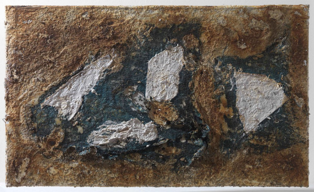Mixed media on canvas:  Burned  materials  -textiles-  resins-   and plastic. Dimensions 70X42.